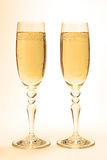 Glasses with champagne. Glasses on a high leg with champagne Stock Photography
