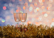 Glasses with champagne on an abstract background Royalty Free Stock Photo