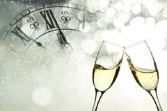 Glasses with champagne against fireworks Royalty Free Stock Images