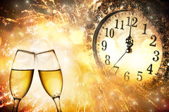 Glasses with champagne against fireworks Stock Image