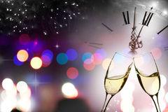 Glasses with champagne against fireworks and clock Stock Photography