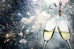 Glasses with champagne against fireworks and clock Stock Image