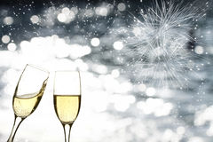 Glasses with champagne against fireworks Royalty Free Stock Photos