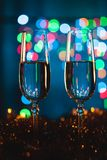 Glasses with champagne against fireworks and holiday lights - Ce Stock Photos