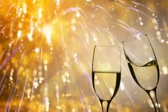Champagne glasses on sparkling background royalty free stock photography