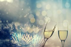 Champagne glasses on sparkling background. Glasses with champagne against fireworks and holiday lights - Celebrating the New Year Royalty Free Stock Photography