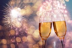 Champagne glasses on sparkling background. Glasses with champagne against fireworks and holiday lights - Celebrating the New Year Royalty Free Stock Photo