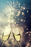 Glasses with champagne against fireworks Royalty Free Stock Image