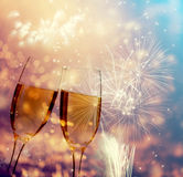 Glasses with champagne against fireworks Stock Images