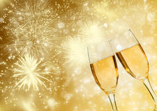 Glasses with champagne against fireworks Stock Photography