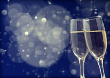 Glasses with champagne. Against holiday background Royalty Free Stock Photography