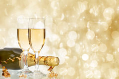 Glasses with champagne against holiday lights Royalty Free Stock Photography