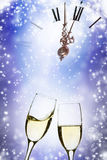 Glasses of champagne against holiday lights Royalty Free Stock Image