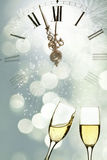 Glasses of champagne against holiday lights Royalty Free Stock Images