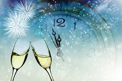 Glasses with champagne and clock close to midnight. Glasses with champagne against holiday lights and clock close to midnight Stock Photos