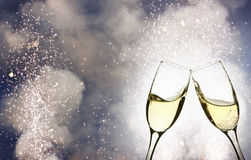Glasses with champagne against holiday lights Stock Images