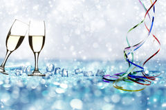 Glasses with champagne against holiday lights Royalty Free Stock Photos