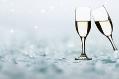 Glasses with champagne against holiday lights Royalty Free Stock Image