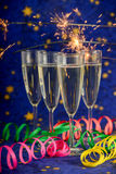 Glasses with champagne against holiday lights Royalty Free Stock Images