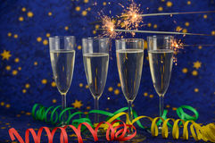 Glasses with champagne against holiday lights Stock Image