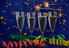 Glasses with champagne against holiday lights Royalty Free Stock Photo