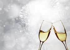 Glasses with champagne against sparkling holiday lights Royalty Free Stock Images