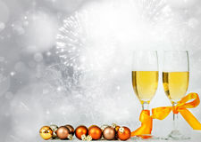Glasses with champagne against sparkling holiday lights Stock Photos
