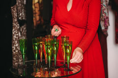 Glasses with champagne alcohol cocktail banquet. Glasses with champagne cocktail banquet party red dress Royalty Free Stock Image