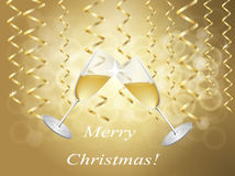 Glasses. Champagne glasses on the background of the serpentine holiday in gold tones Royalty Free Stock Photos