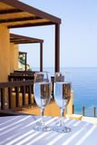 Glasses of champagne on balcony with sea view Stock Photos