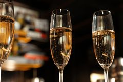 Glasses of champagne in bar stock photo