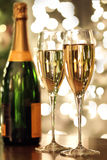Glasses of champagne and bottle. With festive background Royalty Free Stock Image