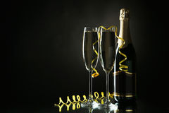 Glasses of champagne with bottle on a black Stock Image