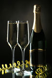 Glasses of champagne with bottle on a black Stock Photos
