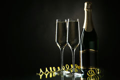 Glasses of champagne with bottle on a black background Royalty Free Stock Photo