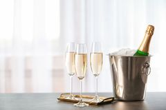 Glasses with champagne and bottle in bucket stock image