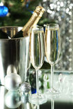 Glasses of champagne with bottle in a bucket on lights Stock Photography