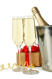 Glasses of champagne with bottle in a bucket on white background Stock Photo