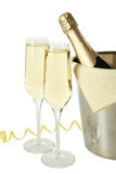 Glasses of champagne with bottle in a bucket on white background Royalty Free Stock Photos