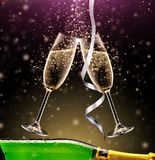 Glasses of champagne with bottle on dark Stock Image