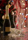 Glasses for champagne and bottle with festive background Stock Photos