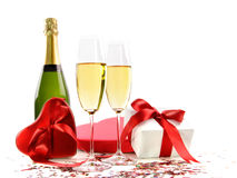 Glasses of champagne with bottle and gifts Stock Photography