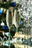 Glasses of champagne with bottle on a lights Stock Photos