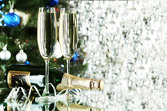 Glasses of champagne with bottle on a lights Royalty Free Stock Image
