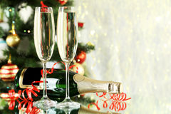 Glasses of champagne with bottle on a lights background Stock Images