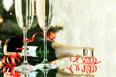 Glasses of champagne with bottle on a lights background, close up Royalty Free Stock Image