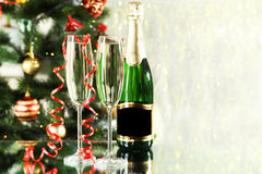 Glasses of champagne with bottle on a lights background, close up Stock Photography