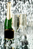 Glasses of champagne with bottle on a lights background Royalty Free Stock Image