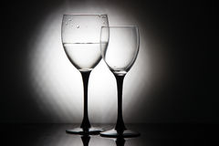 Glasses of champagne and a bottle of wine on a black background Royalty Free Stock Image