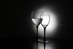 Glasses of champagne and a bottle of wine on a black background Stock Image